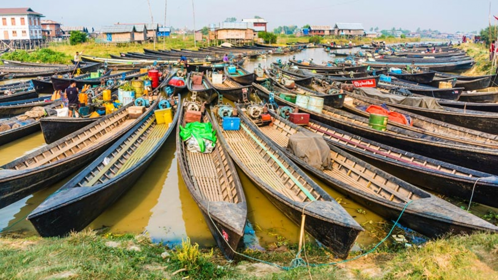 wooden-boats-at-dock-in-the-harbour-at-nampan-myanmar-136425484206302601-180228173703