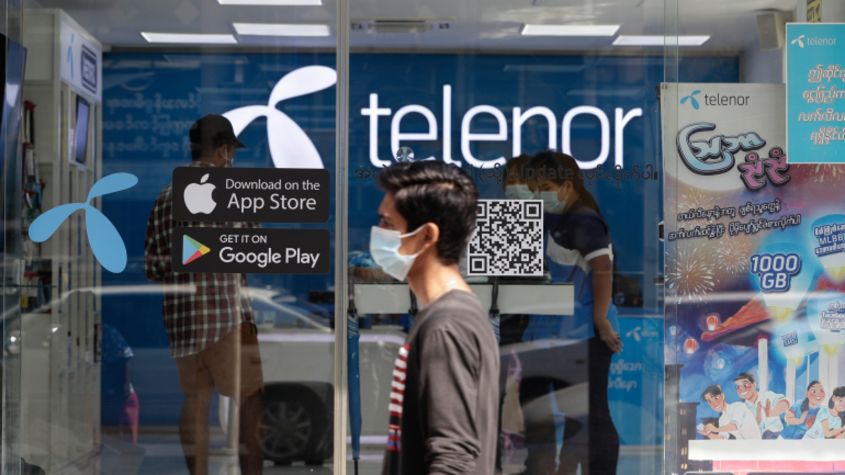 epa08986062 A man walks past a Telenor showroom in downtown Yangon, Myanmar, 04 February 2021. Telenor company announced that all mobile operators, international gateways and internet service providers in Myanmar received a directive on 03 February 2021 to block social media service Facebook. Myanmar?s military seized power and declared a state of emergency for one year after arresting State Counselor Aung San Suu Kyi and Myanmar President Win Myint, along with other political figures, in an early morning raid on 01 February.  EPA-EFE/LYNN BO BO