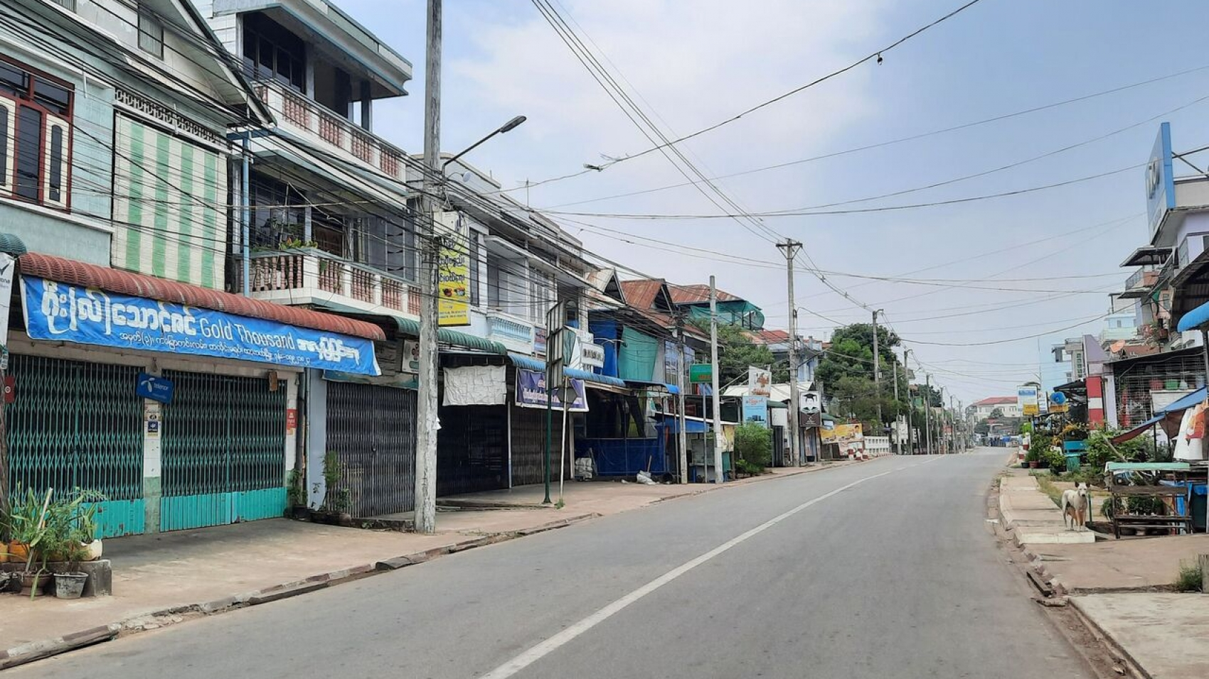 """This handout photo taken and released by Dawei Watch on March 24, 2021 shows an empty street and closed shops in Dawei, as demonstrators called for a """"silent strike"""" in protest against the military coup. (Photo by Handout / DAWEI WATCH / AFP) / RESTRICTED TO EDITORIAL USE - MANDATORY CREDIT """"AFP PHOTO / Dawei Watch """" - NO MARKETING - NO ADVERTISING CAMPAIGNS - DISTRIBUTED AS A SERVICE TO CLIENTS"""