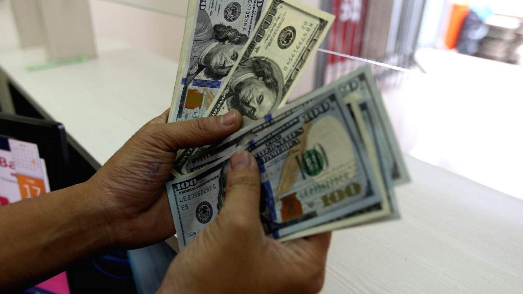 a-clerk-counts-currencies-at-a-foreign-currency-322270